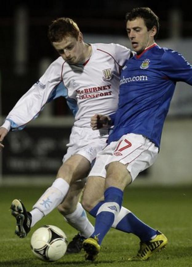 Aaron Stewart of Ballymena battles for possession with Linfield's Gary Browne