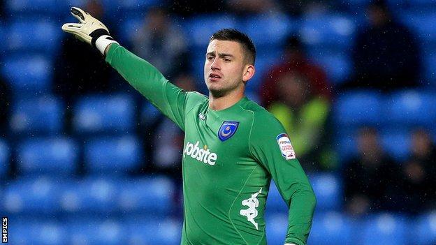 Oldham goalkeeper Alex Cisak