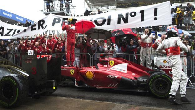 Fernando Alonso (left) and Jenson Button after the Brazilian Grand Prix