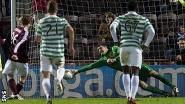 Fraser Forster saves Marius Zaliukas's penalty