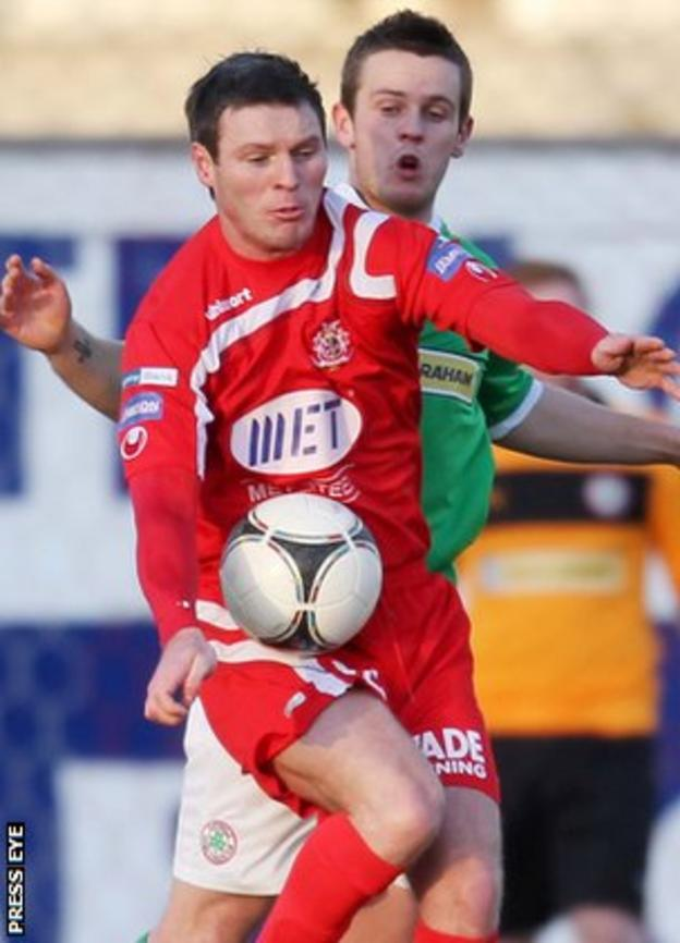 Portadown's Kevin Braniff shields the ball from Cliftonville opponent Jamie McGovern