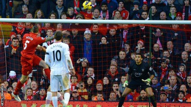 Liverpool defender Daniel Agger (left) heads in a goal against Southampton