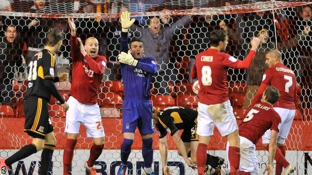 Nottingham Forest's players appeal for handball as Hull City's Paul McShane scores the winning goal