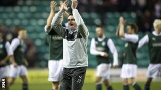 Hibs manager Pat Fenlon salutes the happy home support at Easter Road