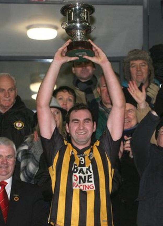 Crossmaglen Rangers captain David McKenna lifts the cup after the final