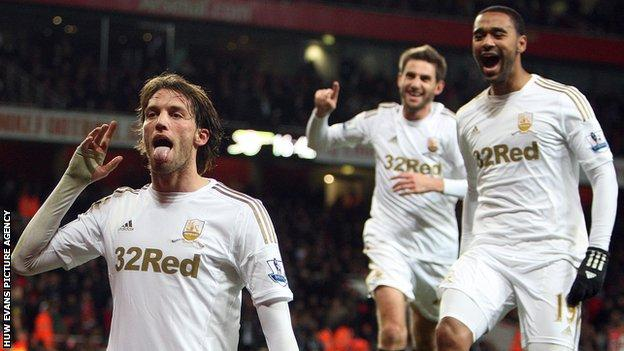 Michu celebrates his first goal against Arsenal, with Angel Rangel showing his delight in the background