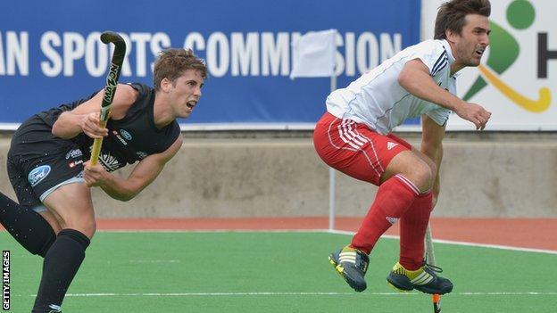 New Zealand's Nicholas Wilson and England's Adam Dixon