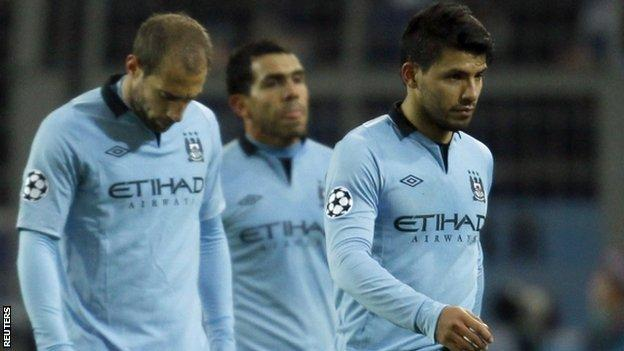 Manchester City's players leave the pitch in dejection after their defeat by Dortmund