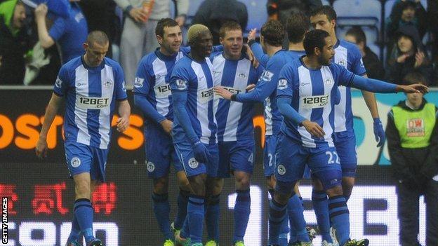 Wigan celebrate James McCarthy's goal against QPR