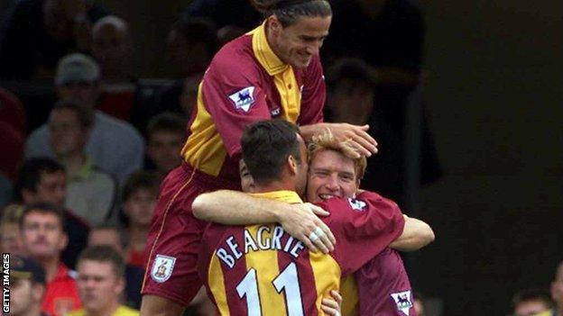 Stuart McCall congratulated by Peter Beagrie and Benito Carbone after scoring against Arsenal