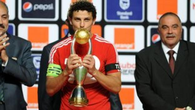 Ahly captain Hossem el Sayed poses with the trophy