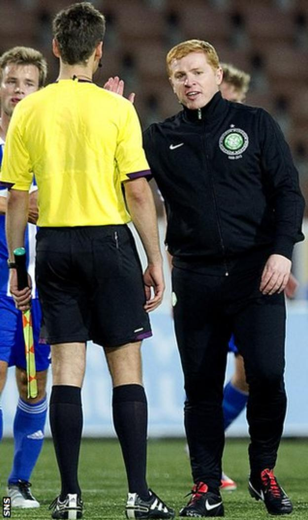 Lennon discusses a decision with an official