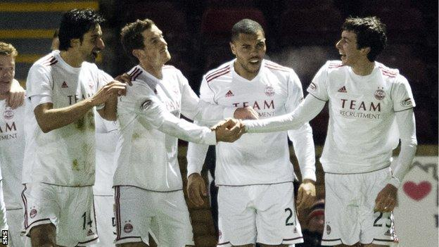 The Aberdeen players celebrate Joe Shaughnessy's (right) goal