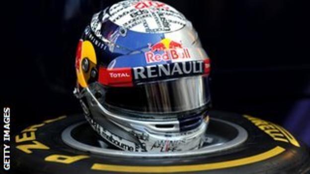 Vettel's helmet resting on a tyre