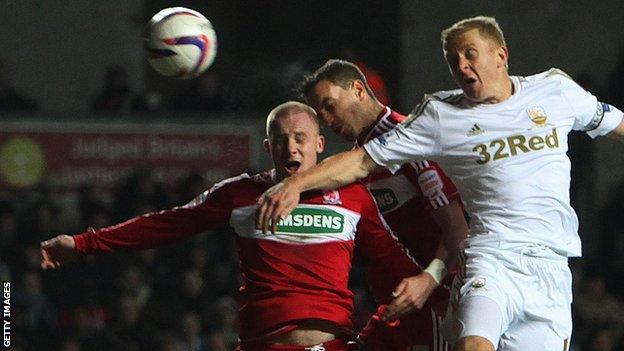 Garry Monk challenges for a corner that led to Swansea's winner against Middlesbrough
