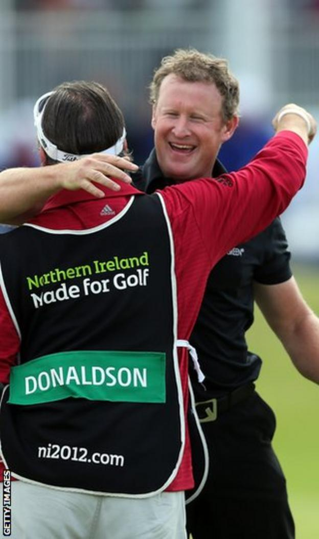Jamie Donaldson hugs his caddie Craig Connelly after winning his first European Tour event at the Irish Open