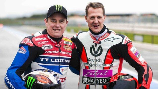 John McGuinness and Michael Schumacher
