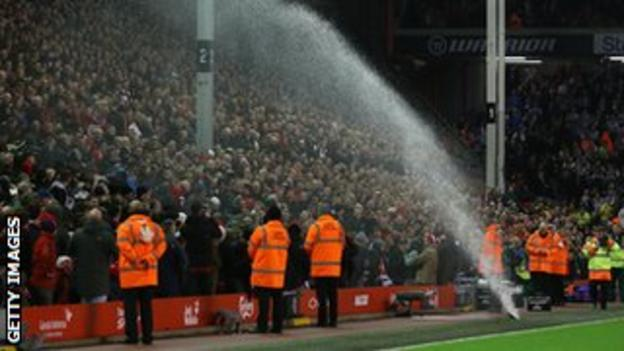 Faulty sprinkler by the side of the Anfield pitch