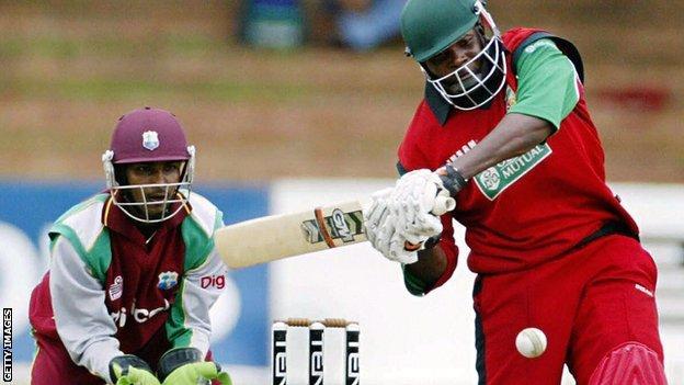 West Indies' Denesh Ramdin and Zimbabwe's Hamilton Masakadza