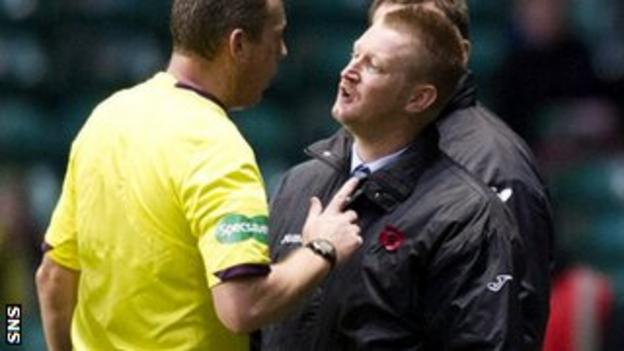 Referee Iain Brines talks with Steve Lomas on the touchline
