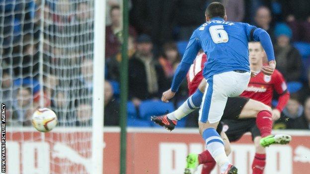Michael Bostwick scores Peterborough's opening goal