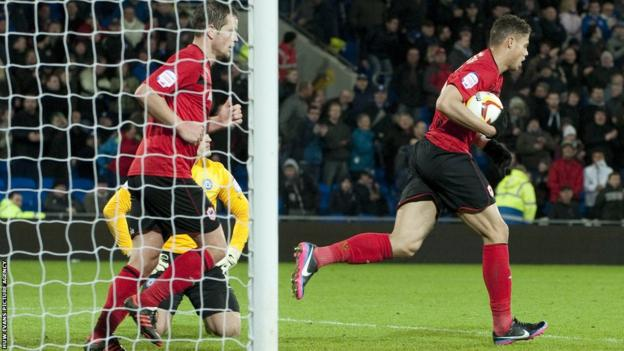 Substitute Rudy Gestede collects the ball after scoring a late goal but it's too little, too late for Cardiff who slump to a first home defeat of the season.
