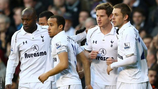 Jan Vertonghen (second from right) is congratulated by his Spurs team-mates after scoring the winner to defeat Swansea.