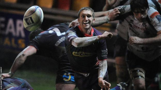 Scrum-half Wayne fires out a pass as Newport Gwent Dragons take on Mogliano in the Amlin Challenge Cup