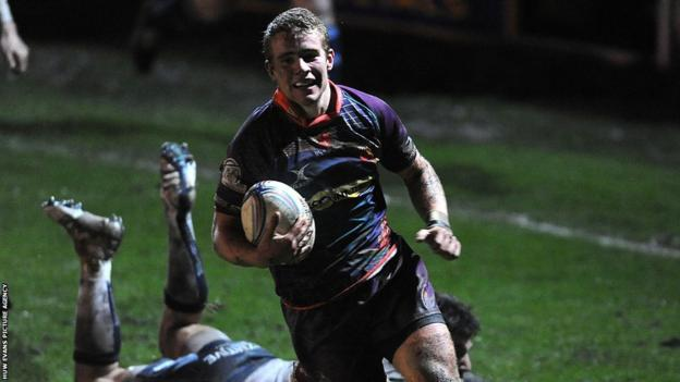 Newport Gwent Dragons' Jonathan Evans runs in for one of his side's eight tries in the Amlin Cup victory over Mogliano at Rodney Parade.