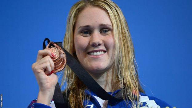 Jemma Lowe shows off her bronze medal after coming third in the 100m butterfly final at the World Short Course Championships in Istanbul.