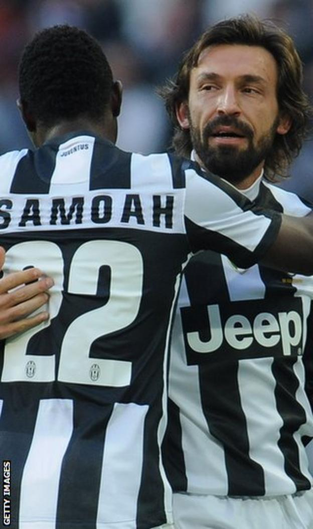 Kwadwo Asamoah and Andrea Pirlo celebrate with Juventus