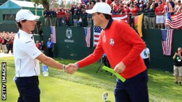 Rory McIlroy greets Keegan Bradley after a dash to make his Ryder Cup tee-off time