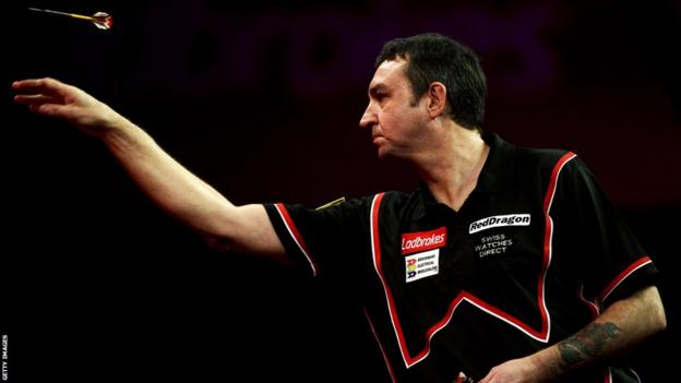 Richie Burnett goes out of the World Darts Championship at the Alexandra Palace, beaten 4-1 by England's Andy Hamilton