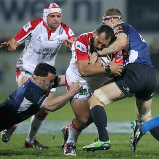 Leinster's Cian Healy and Jamie Heaslip combine to halt the progress of Ulster forward John Afoa