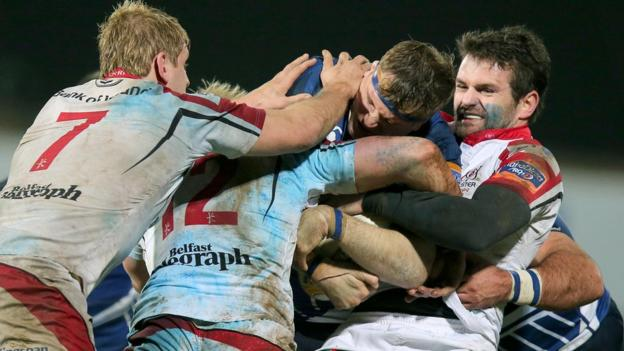 Leinster's Jamie Heaslip tackled by Jared Payne, Luke Marshall and Chris Henry of Ulster