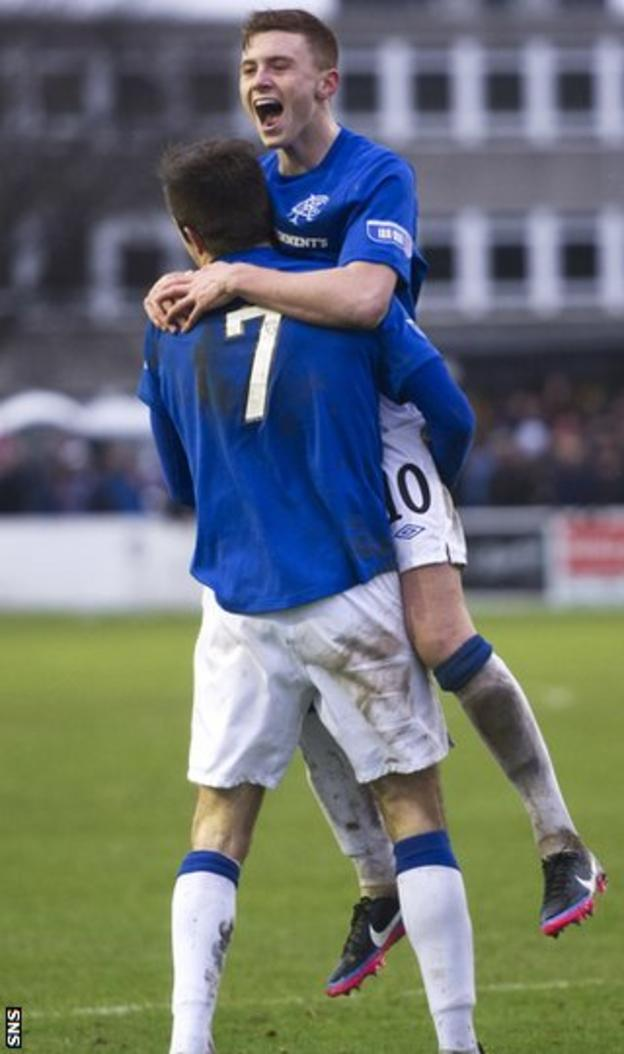 Macleod celebrates with Little after scoring Rangers' fifth goal
