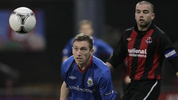 Linfield's Mark McAllister and Crusaders defender Colin Coates