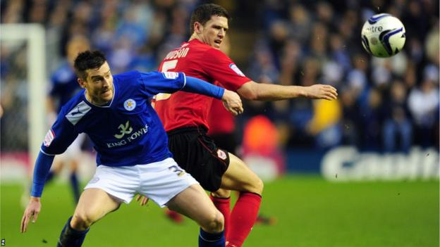 Leicester City's David Nugent (left) and Cardiff City's Mark Hudson battle for the ball