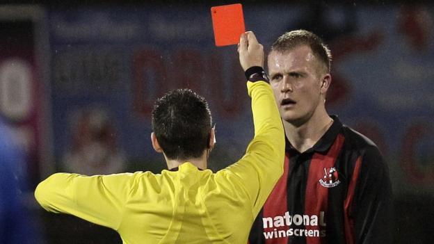 Jordan Owens is sent off by referee Ross Dunlop