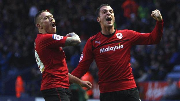 Craig Bellamy and Cardiff team-mate Andrew Taylor celebrate during the 1-0 win at Leicester