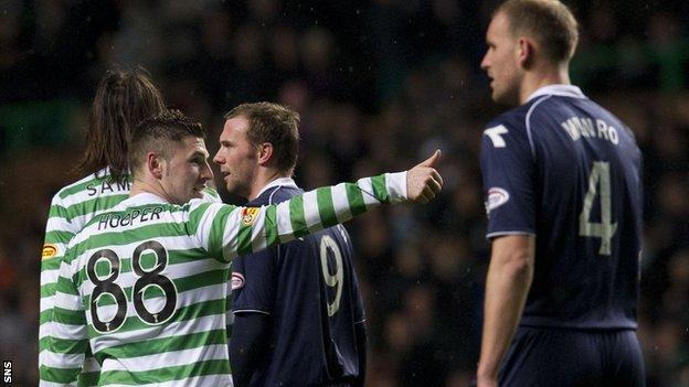 Gary Hooper celebrates as Grant Munro looks disconsolate