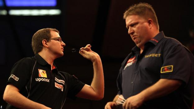 There is no better luck for Mark Webster (left), who bows out of Alexandra Palace after losing 4-2 to Colin Lloyd in the second round of the World Darts Championship