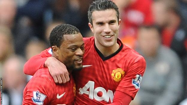 At the Liberty Stadium, Patrice Evra is congratulated by Robin van Persie after giving Manchester United a 16th minute lead against Swansea City.