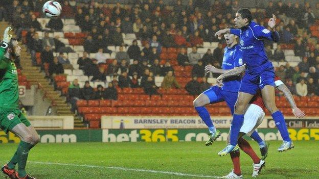 Curtis Davies (right) heads Birmingham's winner at Barnsley