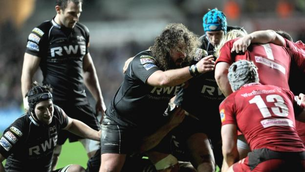Prop Adam Jones (centre) makes his first start for two months after injury and he is part of a dominant Ospreys scrum that earns a penalty try against Scarlets