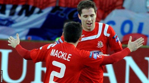 Sean Mackle congratulates Portadown goalscorer Richard Lecky