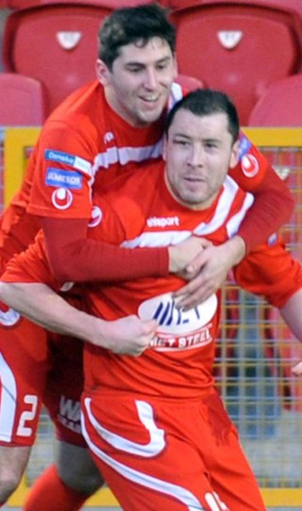 Sean Mackle gets on board to congratulate goalscorer Brian Gartland in the 2-0 win over Coleraine