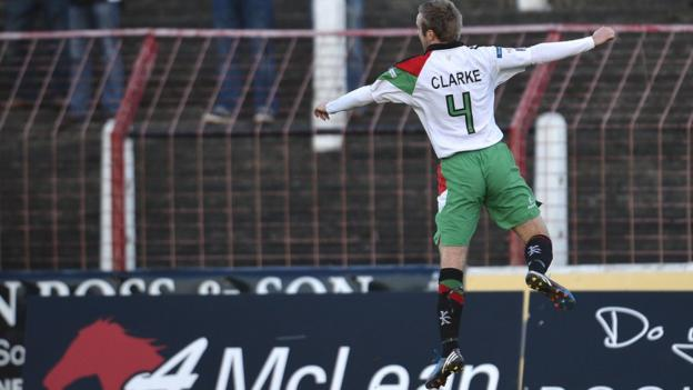 Glentoran midfielder Richard Clarke takes to the air after scoring the opener against Donegal Celtic at the Oval