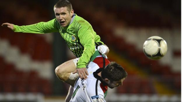 Donegal Celtic's Dean Ryans gets above Stephen Carson to head clear during the 5-0 defeat by Glentoran