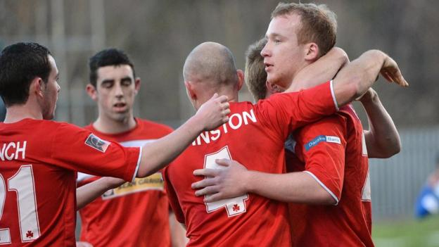 Liam Boyce is congratulated after scoring the first goal for leaders Cliftonville in the 2-0 victory over Dungannon Swifts